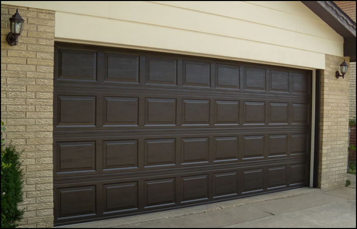 steel-garage-doors-brown-raised-panel-steel-door-with-traditional-short-panel-design